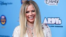 Avril Lavigne turns heads in plunging V-neck jumpsuit