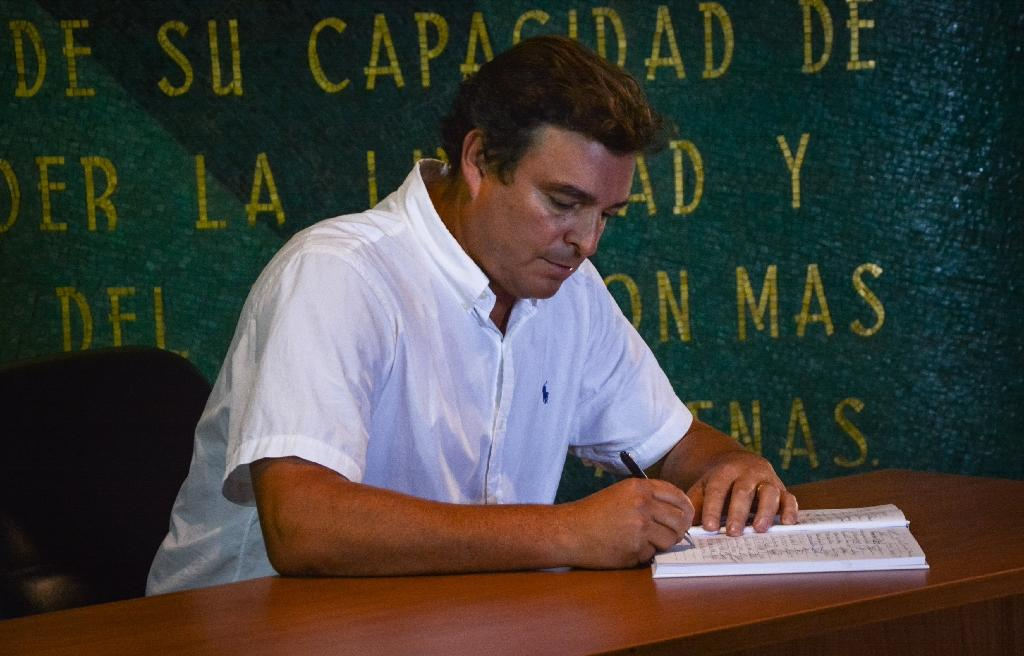 Son of Revolutionary leader Fidel Castro, Antonio Castro Soto del Valle and many others, signed an oath of allegiance to his father's revolution concept at Revolution Square Jose Marti's memorial in Havana, on November 28, 2016 (AFP Photo/)