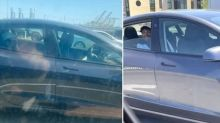 Concerned drivers spot Tesla driving itself in California with smiling man in backseat