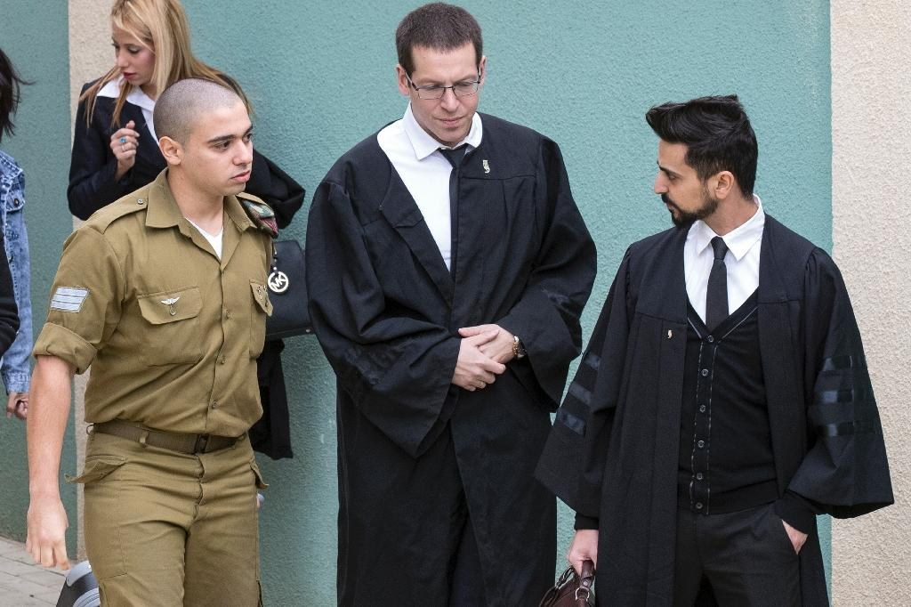 Israeli soldier Elor Azaria (L) had been on trial in a military court since May 2016 for shooting dead a wounded Palestinian assailant (AFP Photo/Jack Guez)