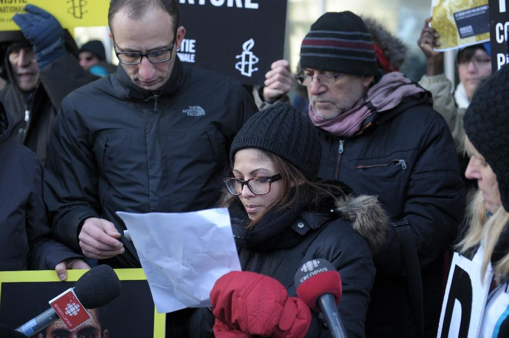 """Ensaf Haidar, the wife of jailed Saudi Blogger Raif Badawi, holds a vigil in Canada's Montreal in January 2015, urging Saudi Arabia to free her husband, days after he received 50 lashes for """"insulting Islam"""""""