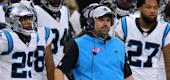 Panthers coach Matt Rhule flanked by players. (Getty Images)
