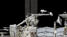 Spacewalking astronauts slice into cosmic ray detector