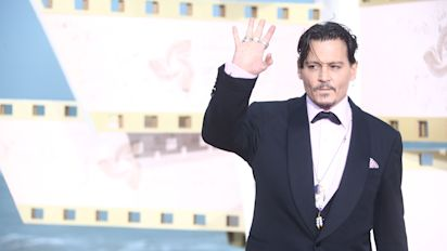 Depp's battle with former lawyers delayed
