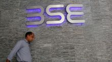 Sensex reverses course to end lower as financials drag