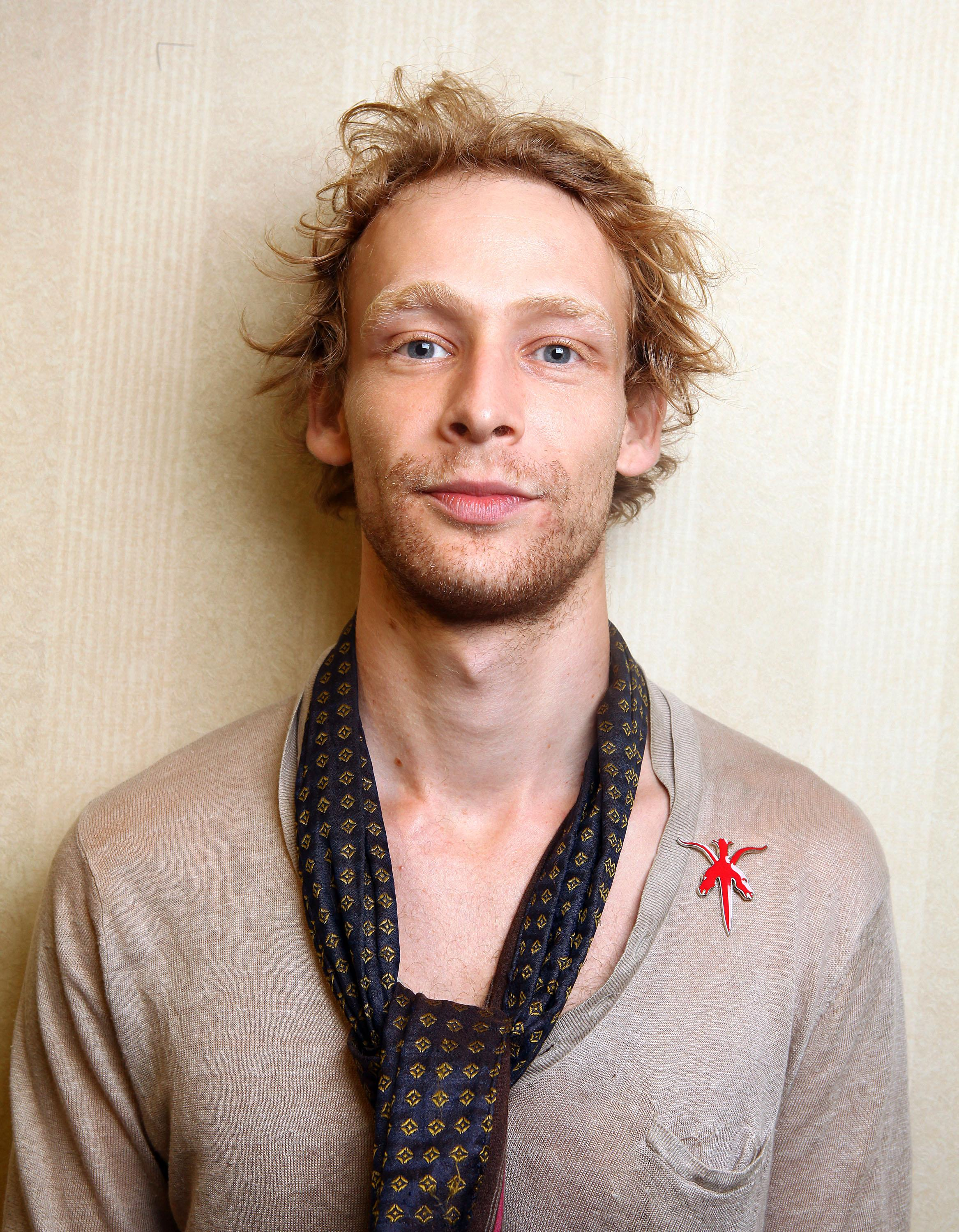 """FILE - This Sept. 14, 2011 file photo shows actor Johnny Lewis posing for a portrait during the 36th Toronto International Film Festival in Toronto, Canada. Authorities say Lewis fell to his death after killing an elderly Los Angeles woman. Lewis appeared in the FX television show """"Sons of Anarchy,"""" for two seasons. The woman killed is identified as 81-year-old Catherine Davis. (AP Photo/Carlo Allegri, file)"""
