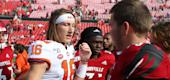 Clemson Tigers quarterback Trevor Lawrence, left, shakes hands after the game against the Louisville Cardinals. (Getty Images)