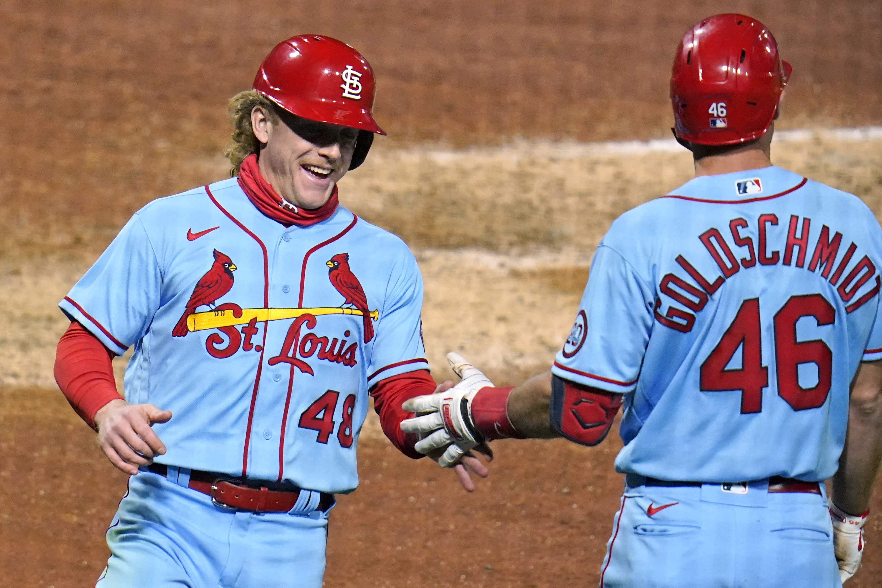 CORRECTS TO SINGLE, INSTEAD OF DOUBLE - St. Louis Cardinals' Harrison Bader celebrates with Paul Goldschmidt after scoring on a single by Tommy Edman during the seventh inning of the team's baseball game against the Pittsburgh Pirates in Pittsburgh, Saturday, Sept. 19, 2020. (AP Photo/Gene J. Puskar)