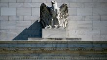Global stock markets fall on Fed warning