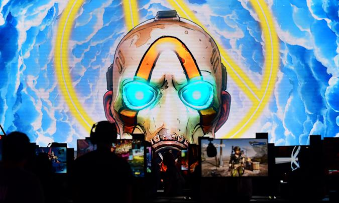 "Gaming fans play ""Borderlands 3"" at the 2019 Electronic Entertainment Expo, also known as E3, in Los Angeles on June 11, 2019. - Gaming fans and developers gather, connecting thousands of the brightest, best and most innovative in the interactive entertainment industry and a chance for many to preview new games. (Photo by Frederic J. BROWN / AFP)        (Photo credit should read FREDERIC J. BROWN/AFP via Getty Images)"