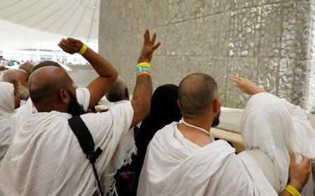 Muslim pilgrims cast their stones at a pillar symbolising the stoning of Satan during the annual haj pilgrimage in Mina