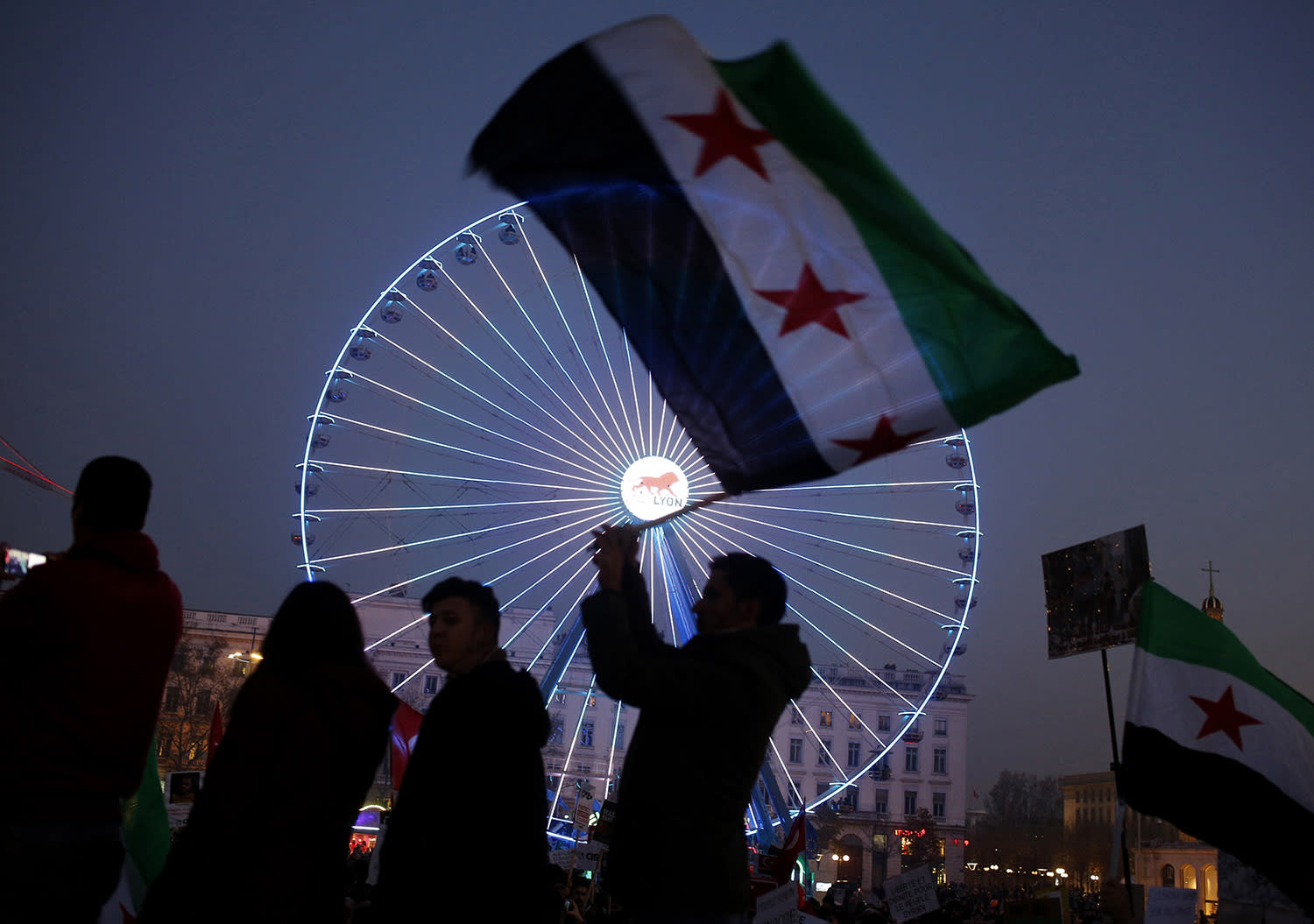 <p>A man waves a Syrian flag during a gathering to protest against the war and the humanitarian crisis in Aleppo, in Lyon, central France, Dec. 17, 2016. (Photo: Laurent Cipriani/AP) </p>