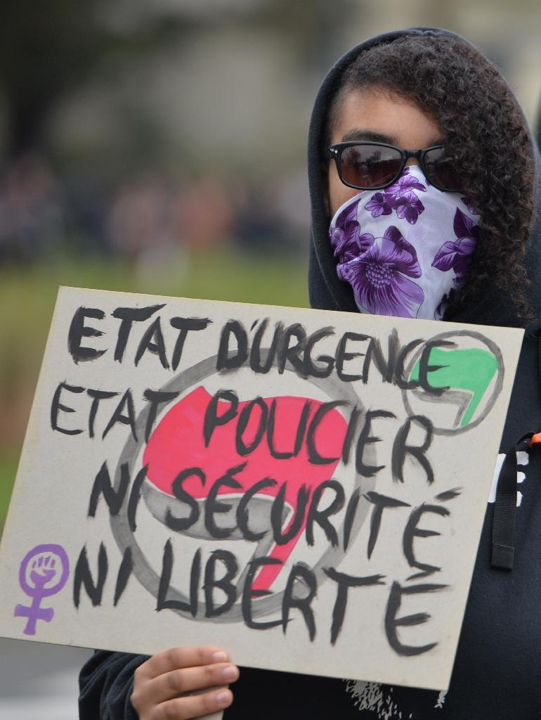 "A demonstrator in Rennes on January 23, 2016 holds a sign reading ""State of emergency, police state, no security, no freedom"" (AFP Photo/Jean-Francois Monier)"