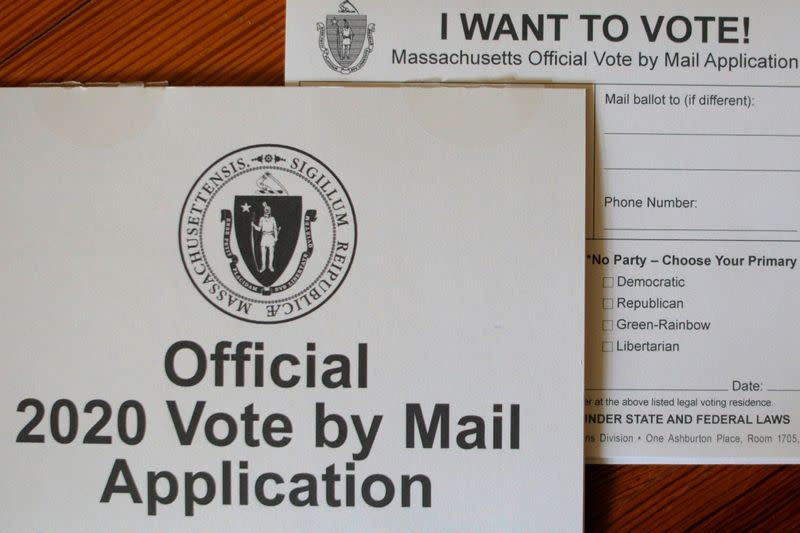 """FILE PHOTO: An """"Official 2020 Vote by Mail Application"""" for the state of Massachusetts is displayed in a photo illustration"""