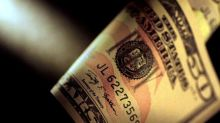 Dollar steadies as Fed minutes weigh on stocks, yuan
