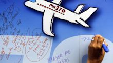 Australia defends end of MH370 hunt; investigation continues