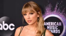 Taylor Swift makes telling fashion statement on 2019 AMAs red carpet amid latest feud