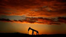 Oil largely steady amid forecast of U.S. crude build, stronger dollar