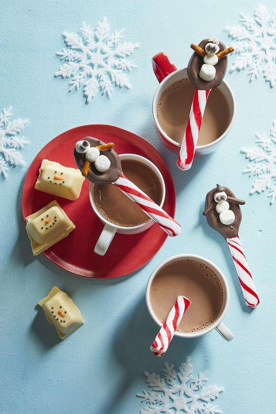 """<p>These festive candy cane spoons make the perfect gift for the<a href=""""https://www.redbookmag.com/food-recipes/recipes/g3926/14-things-to-do-with-hot-chocolate-besides-drink-it/"""" rel=""""nofollow noopener"""" target=""""_blank"""" data-ylk=""""slk:hot chocolate"""" class=""""link rapid-noclick-resp""""> hot chocolate</a> lover in your life. </p><p><strong><a href=""""https://www.womansday.com/food-recipes/food-drinks/recipes/a60669/snowman-spoons-recipe/"""" rel=""""nofollow noopener"""" target=""""_blank"""" data-ylk=""""slk:Get the recipe."""" class=""""link rapid-noclick-resp"""">Get the recipe. </a></strong></p>"""
