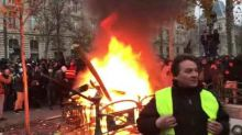 Pension Protesters Sing La Marseillaise as Fire Burns in Central Paris