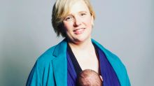 Labour MP Stella Creasy poses with her baby in a sling for official parliamentary portrait