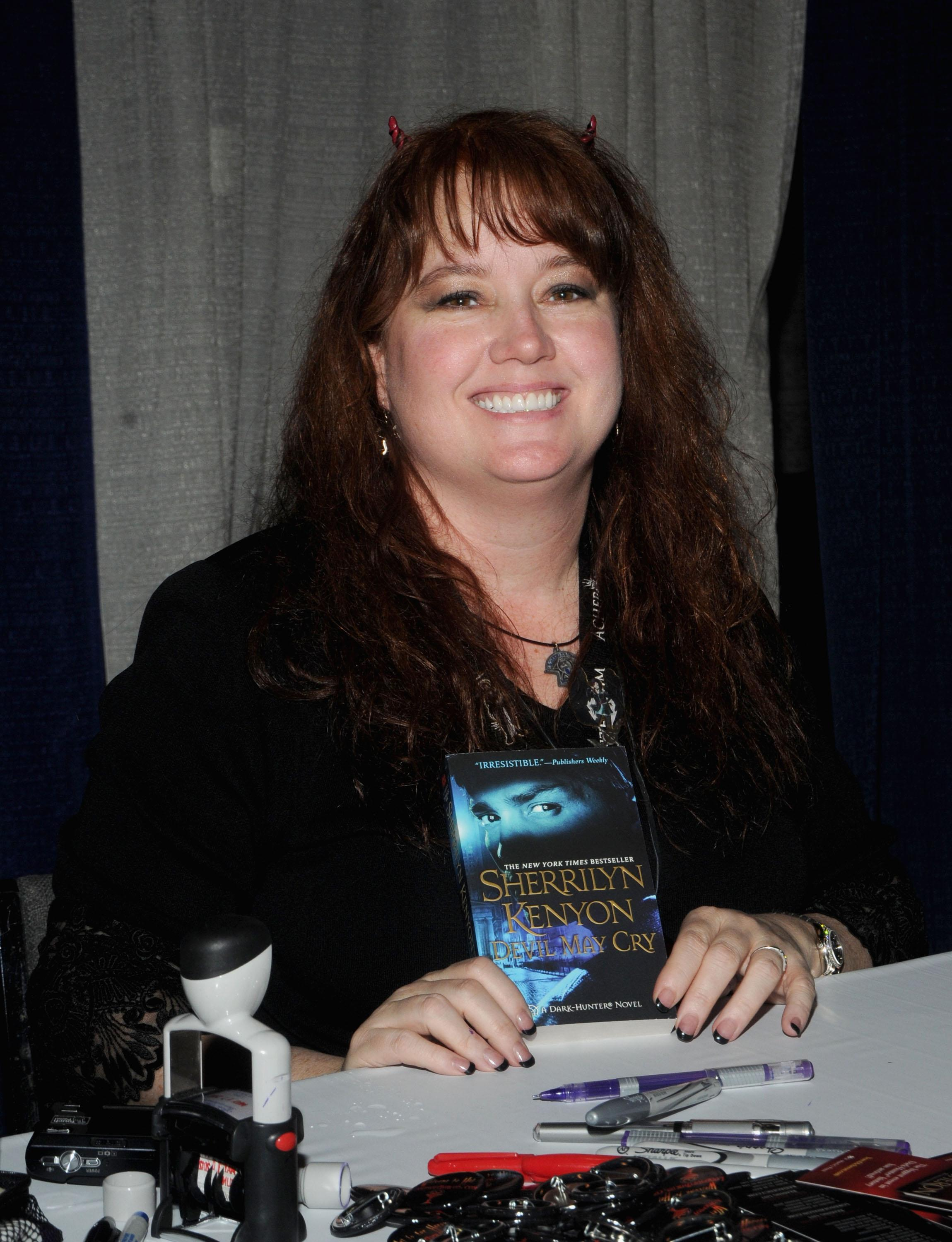 Best-selling author Sherrilyn Kenyon tells fans she suspects her husband poisoned her
