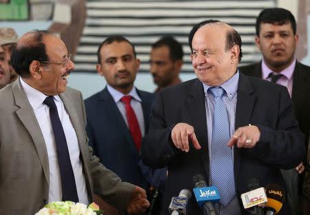 Yemen's President Abd-Rabbu Mansour Hadi (R) talks with his deputy Ali Muhssien al-Ahmar during a visit to the country's northern province of Marib July 10, 2016. REUTERS/Ali Owidha