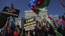 Azerbaijan says Armenia targets cities outside conflict zone