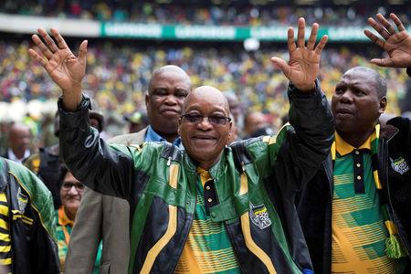 South African President Jacob Zuma greets supporters at a rally to commemorate the 105th birthday of his ruling African National Congress in Soweto