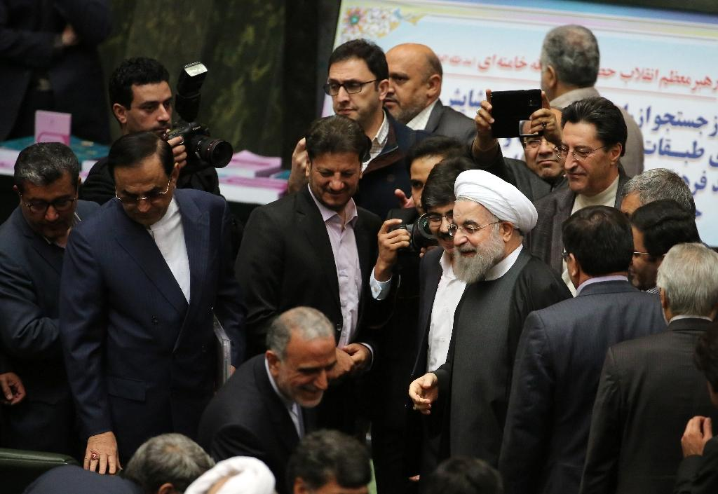 Iranian President Hassan Rouhani (C) arrives in parliament ahead of presenting the proposed annual budget in the capital Tehran, on January 17, 2016, after sanctions were lifted under Tehran's nuclear deal with world powers