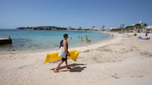 Tourists must quarantine on return home from Spain