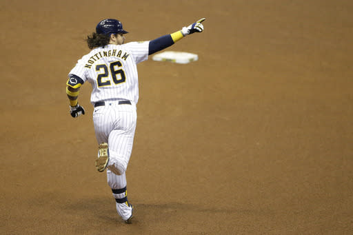 Milwaukee Brewers' Jacob Nottingham gestures after hitting a grand slam during the fourth inning of a baseball game against the Kansas City Royals, Friday, Sept. 18, 2020, in Milwaukee. (AP Photo/Aaron Gash)