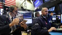 Stocks slip, housing starts stall