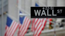 Wall Street edges higher on strong earnings