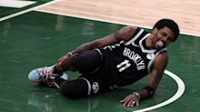 Bucks rout Nets after Kyrie Irving injures ankle landing on Giannis' foot