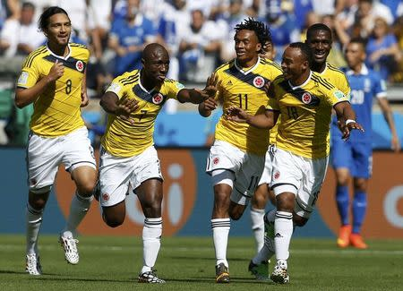Colombia's Armero celebrates his goal against Greece with his teammates during their 2014 World Cup Group C soccer match at the Mineirao stadium in Belo Horizonte