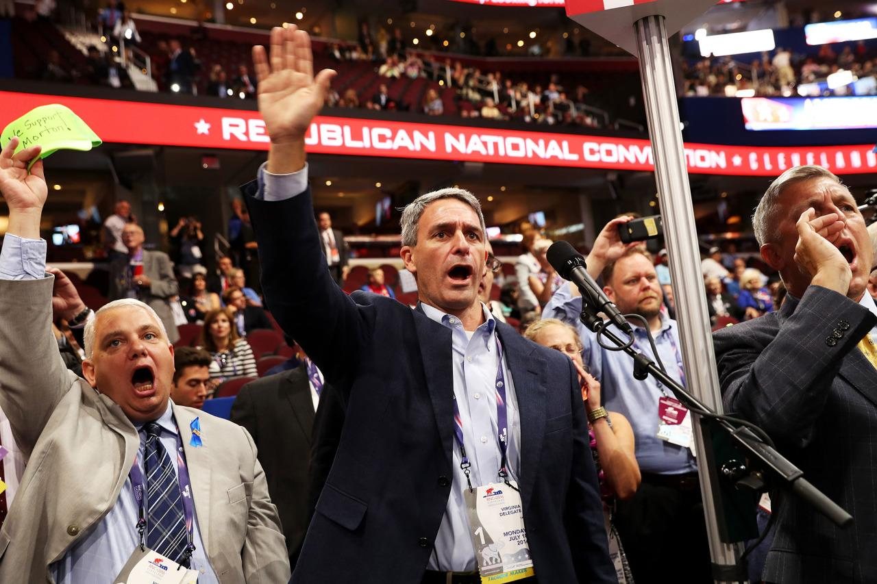 <p>Virginia delegates chant for rules vote on the first day of the Republican National Convention on July 18, 2016 at the Quicken Loans Arena in Cleveland, Ohio. (John Moore/Getty Images)</p>
