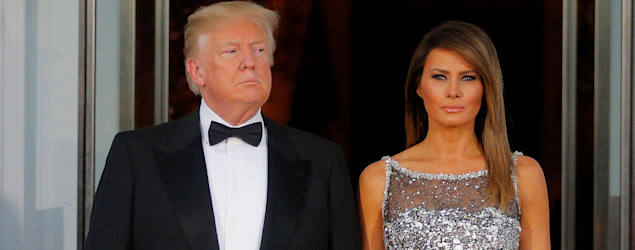Melania Trump sparkles in silver Chanel for first official state dinner. (Reuters)