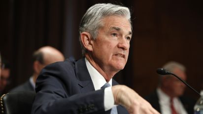 Wall St. thinks Fed will signal an extra rate hike