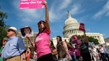 Sit-ins, marches and rallies as activists around the country fight Republican health care bill