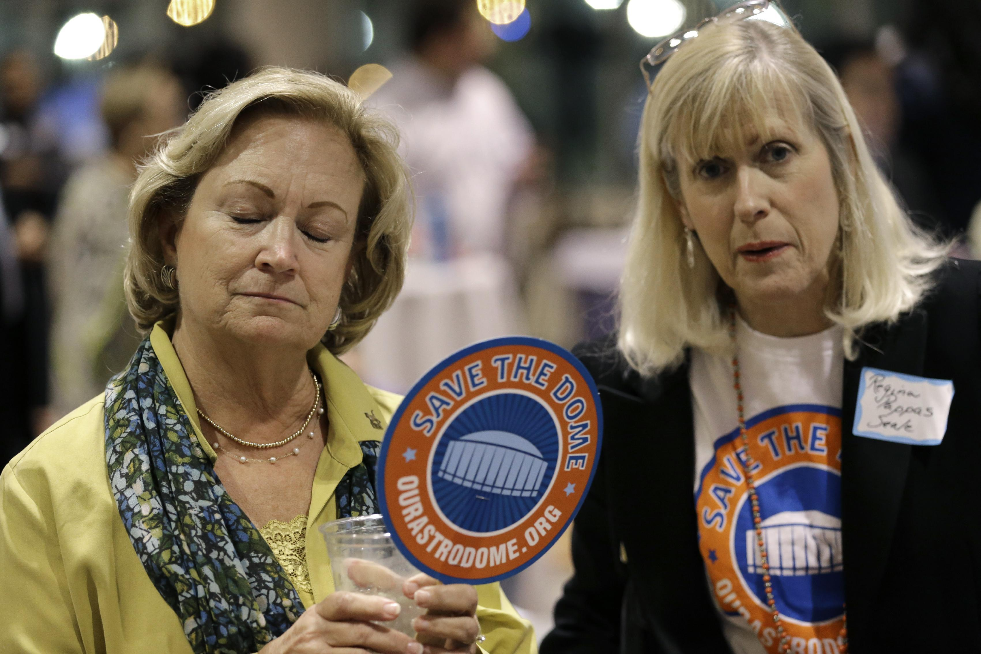 Sally Allen, left, talks with Regina Pappas Seale, right, Tuesday, Nov. 5, 2013, in Houston. Houston-area voters are deciding whether to convert the Astrodome into a convention center or allow the iconic stadium to be demolished.(AP Photo/David J. Phillip)