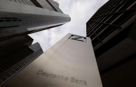FILE PHOTO: The logo of Deutsche Bank is seen in front of one of the bank's office buildings in Frankfurt, Germany, October 27, 2016. REUTERS/Kai Pfaffenbach/File Photo