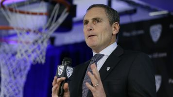 Pac-12 's Scott drowning in sea of scandals