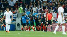 Photographer gets dog-piled as Croatia celebrate winning goal against England