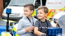 Boy, 8, left virtually blind by rare disease, ticks off bucket list dream by being police officer for a day