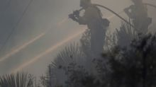 Firefighters wrest control over half of massive California wildfire