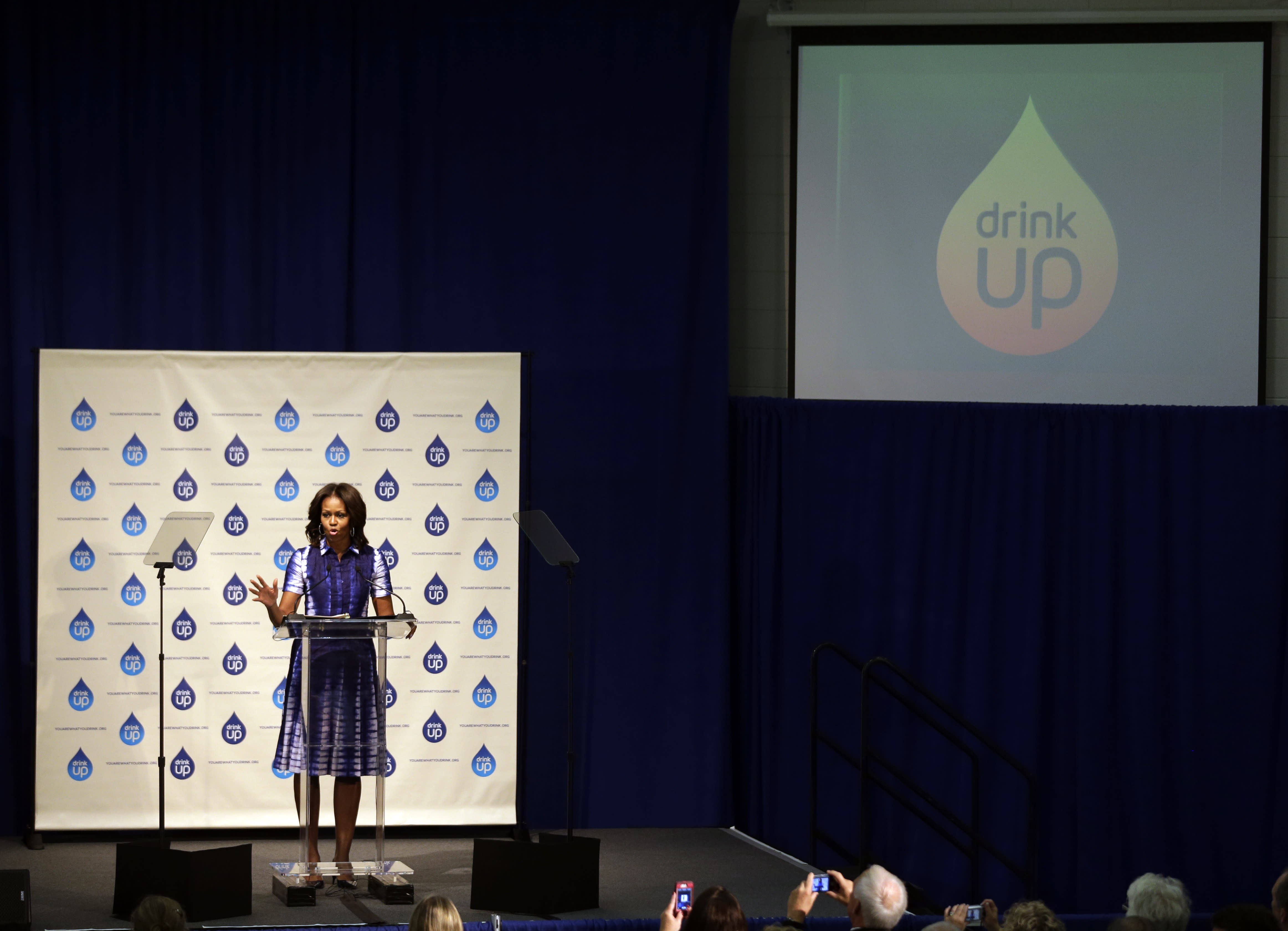 First lady Michelle Obama speaks during an event at Watertown High School to encourage people to drink more water, Thursday, Sept. 12, 2013, in Watertown, Wis. (AP Photo/Morry Gash)