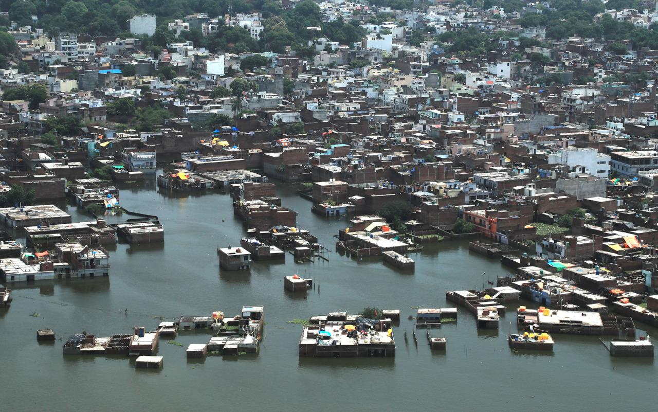 <p>Residential areas are seen marooned in the river Ganges flood waters in Allahabad, India, Friday, Aug. 26, 2016. (AP Photo/Rajesh Kumar Singh)</p>