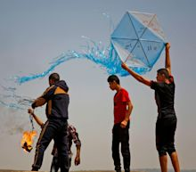 Israel strikes at launchers of burning kites from Gaza Strip