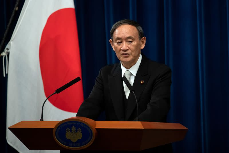 FILE PHOTO: Yoshihide Suga speaks during a news conference following his confirmation as Prime Minister of Japan in Tokyo